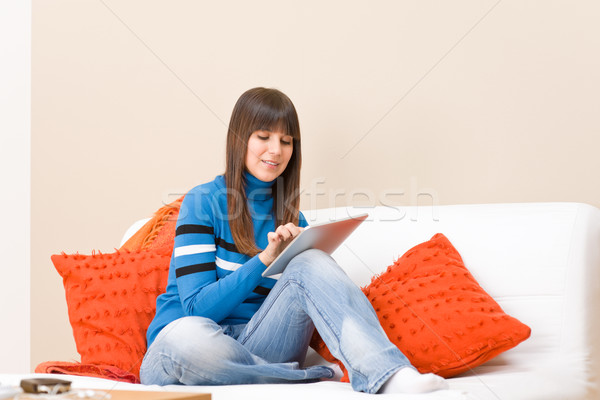 Teenager girl relax home with touch screen tablet computer Stock photo © CandyboxPhoto