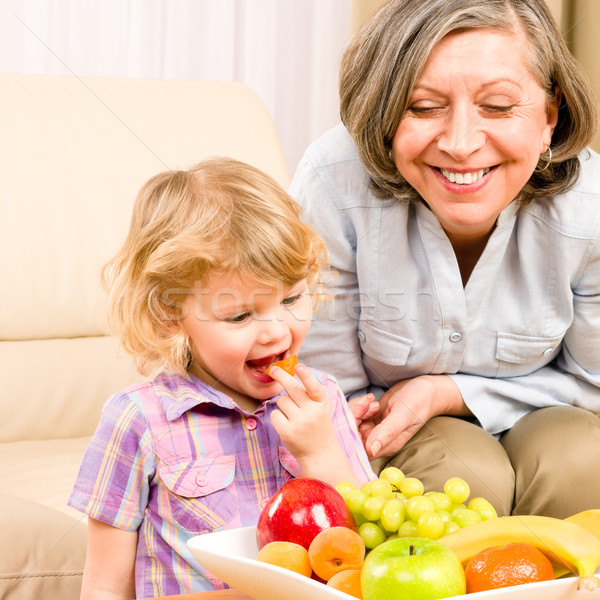 Little girl eat apricot fruit with grandmother Stock photo © CandyboxPhoto