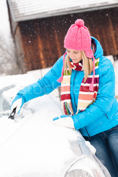 Woman cleaning snow car hood with scraper Stock photo © CandyboxPhoto