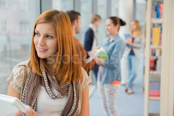 Figyelmes egyetemi hallgató könyvtár osztálytársak lány technológia Stock fotó © CandyboxPhoto