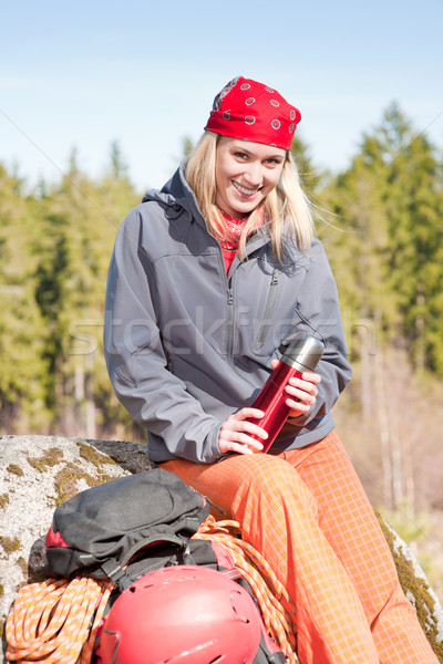 Active woman rock climbing with thermosbottle Stock photo © CandyboxPhoto