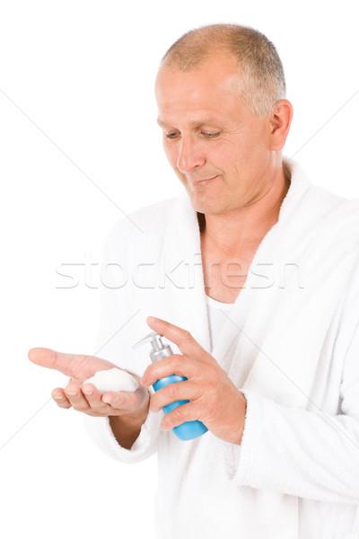 Male cosmetics - senior mature man wash face Stock photo © CandyboxPhoto