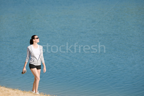 Summer sport fit woman walk on beach Stock photo © CandyboxPhoto