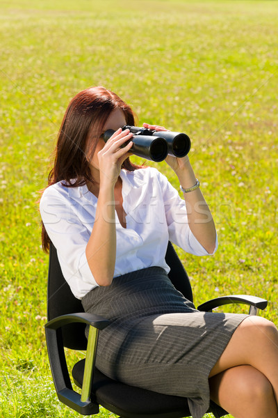 Businesswoman sit in sunny meadow seek binocular Stock photo © CandyboxPhoto