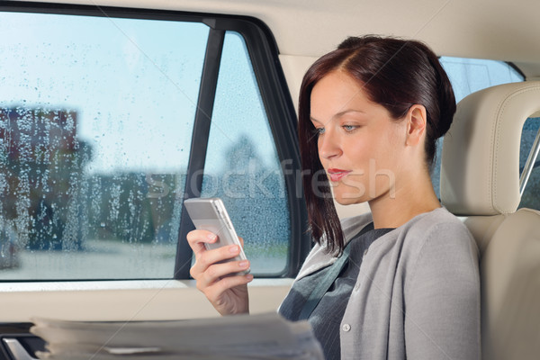 Executive woman manager sitting in car calling Stock photo © CandyboxPhoto