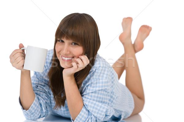 Vrouwelijke tiener pyjama beker thee glimlachend Stockfoto © CandyboxPhoto