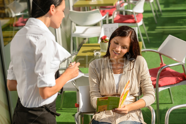 Woman order from waitress at cafe terrace Stock photo © CandyboxPhoto