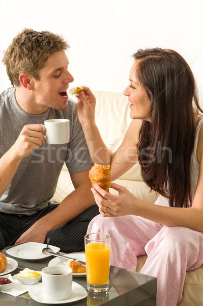 Zorgeloos paar eten ontbijt pyjama home Stockfoto © CandyboxPhoto