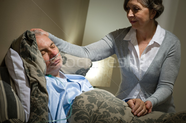 Sick lying senior man and caring wife Stock photo © CandyboxPhoto