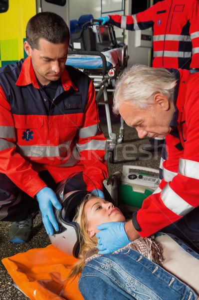 Paramedics removing helmet from motorcycle driver Stock photo © CandyboxPhoto