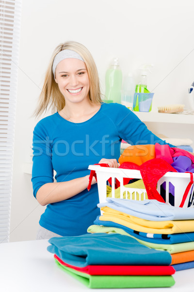 Laundry - woman folding clothes home Stock photo © CandyboxPhoto