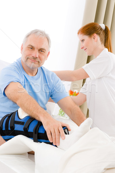 Hospital - female nurse care patient broken leg Stock photo © CandyboxPhoto