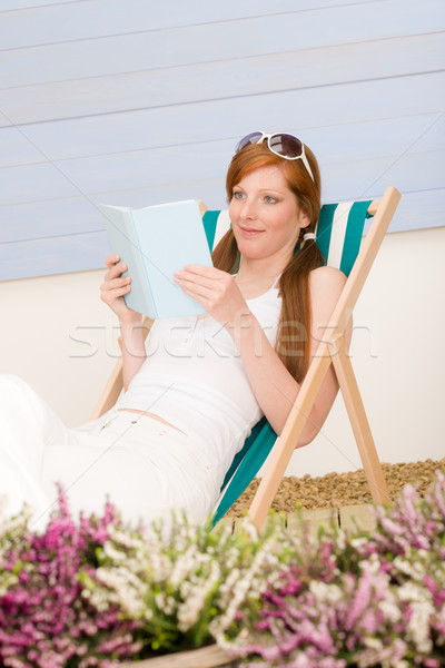 Summer terrace red hair woman relax in deckchair Stock photo © CandyboxPhoto