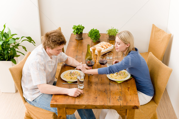 Stock photo: Dinner romantic couple enjoy wine eat pasta