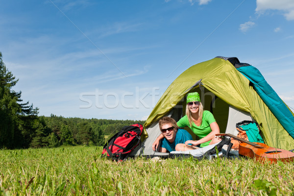 Camping couple lying inside tent summer countryside Stock photo © CandyboxPhoto