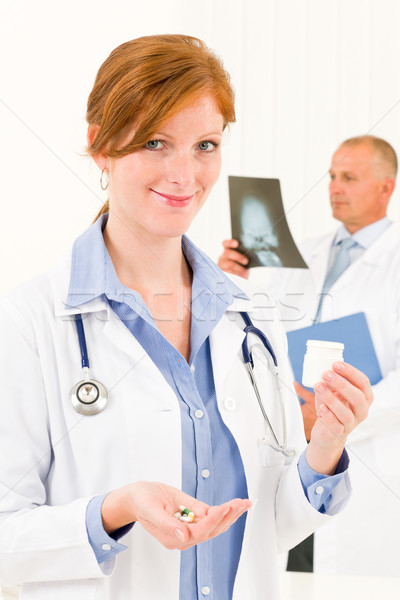 Medical doctor team young woman hold pills Stock photo © CandyboxPhoto