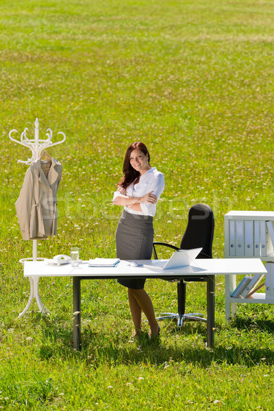 Businesswoman in sunny meadow nature office smile Stock photo © CandyboxPhoto