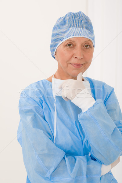 Senior surgeon female with operation clothes mask Stock photo © CandyboxPhoto