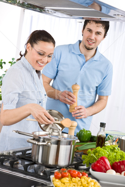 Happy couple cooking in modern kitchen Stock photo © CandyboxPhoto