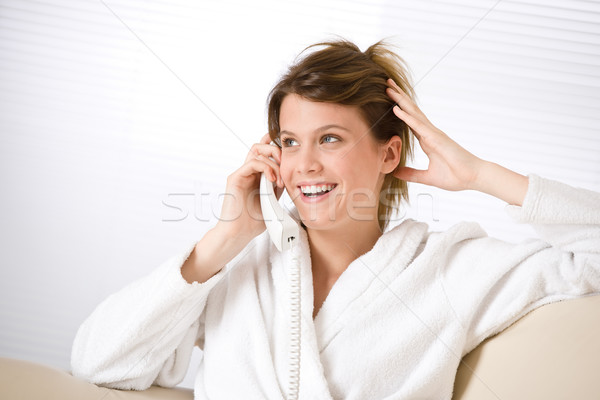 Happy woman in white bathrobe with phone  Stock photo © CandyboxPhoto