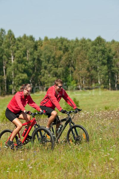 Paardrijden mountainbike voorjaar weide Stockfoto © CandyboxPhoto