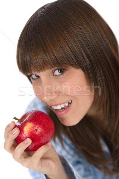 Felice adolescente pigiama mangiare sano mela colazione Foto d'archivio © CandyboxPhoto