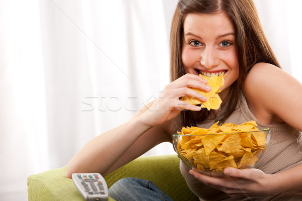 Student series - Young woman eating potato chips Stock photo © CandyboxPhoto