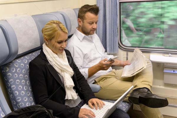 Nő laptop férfi újság vonat sms chat Stock fotó © CandyboxPhoto