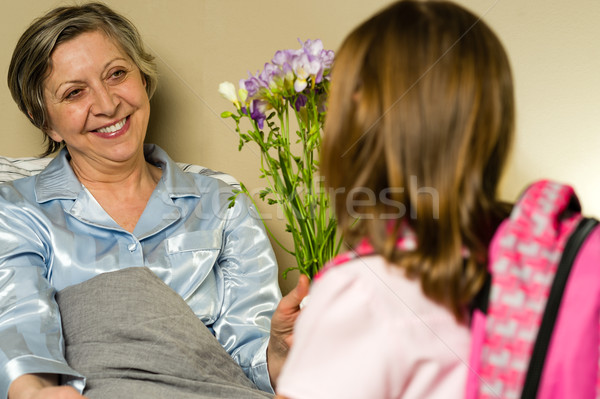 Little girl visiting her ill grandmother Stock photo © CandyboxPhoto