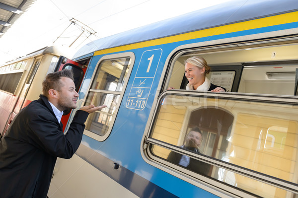 Man blowing kiss to woman on train Stock photo © CandyboxPhoto