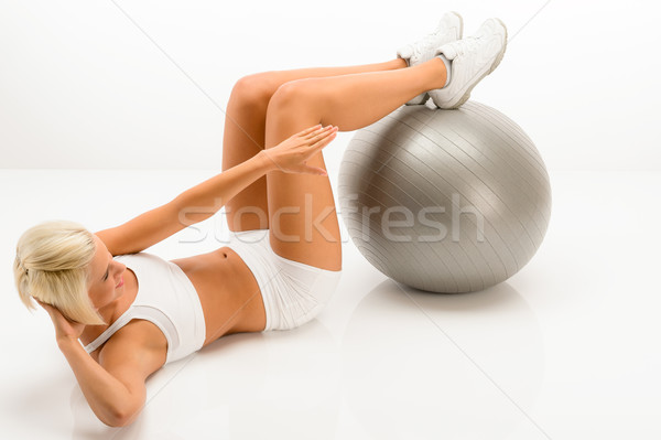 Woman doing sit-ups on fitness ball white Stock photo © CandyboxPhoto