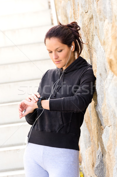Young woman checking after exercising sport sweatsuit Stock photo © CandyboxPhoto