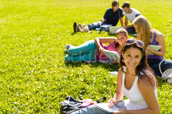 Students studying sitting on grass in park Stock photo © CandyboxPhoto