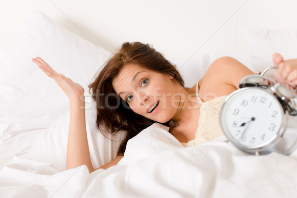 Bedroom - woman with alarm clock wake up Stock photo © CandyboxPhoto
