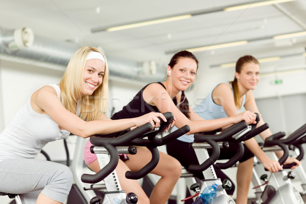 Fitness young woman on gym bike spinning Stock photo © CandyboxPhoto