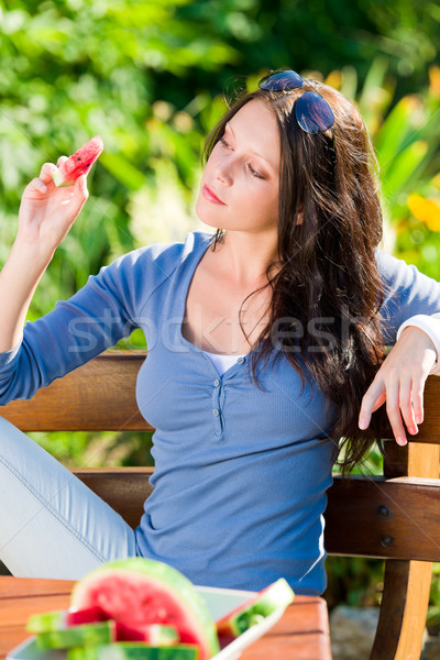 Eating fresh melon beautiful young woman bench Stock photo © CandyboxPhoto