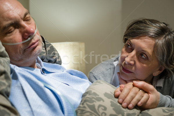 Anxious old woman taking care of husband Stock photo © CandyboxPhoto