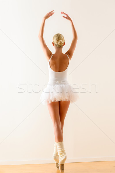 Ballerina pose from behind dancing in studio Stock photo © CandyboxPhoto