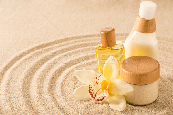 Stock photo: Spa body product on sand orchid flower