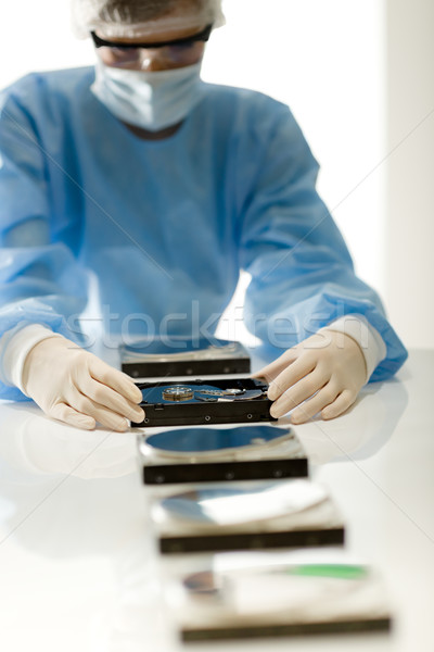 Female computer engineer repair hard disc defect, sterile Stock photo © CandyboxPhoto