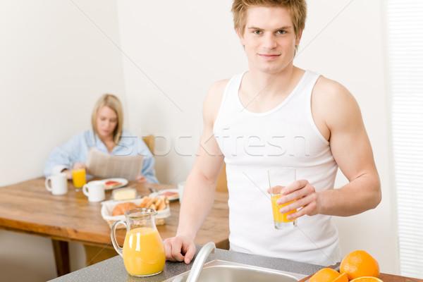 Stockfoto: Ontbijt · gelukkig · paar · sinaasappelsap · ochtend