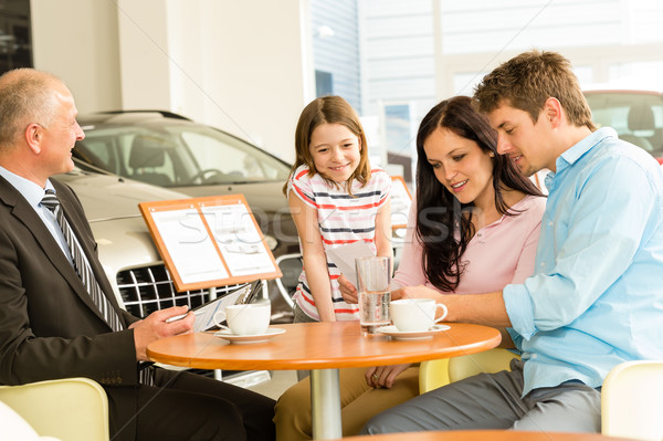 Couple reading papers in car dealership Stock photo © CandyboxPhoto
