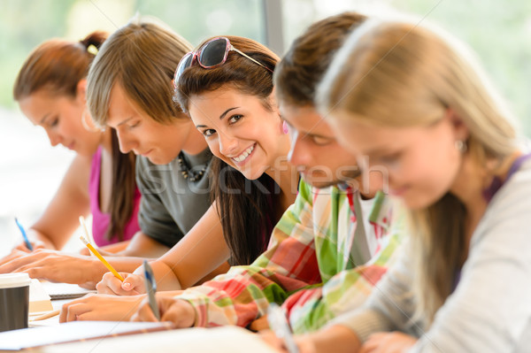 Stock photo: Students writing at high-school exam teens study