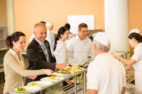 Business colleagues cook serve lunch canteen food Stock photo © CandyboxPhoto