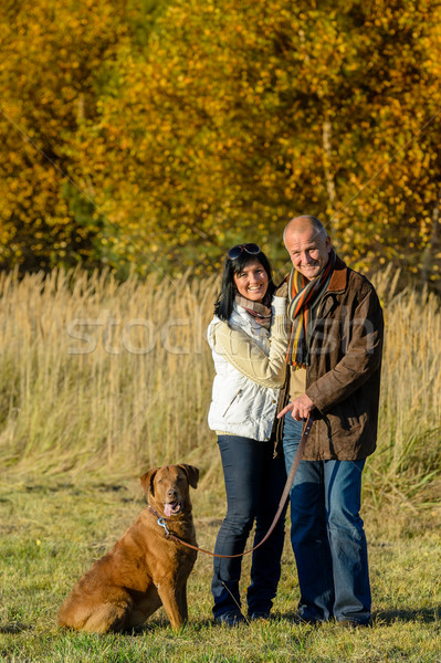Couple with dog in park autumn sunset Stock photo © CandyboxPhoto
