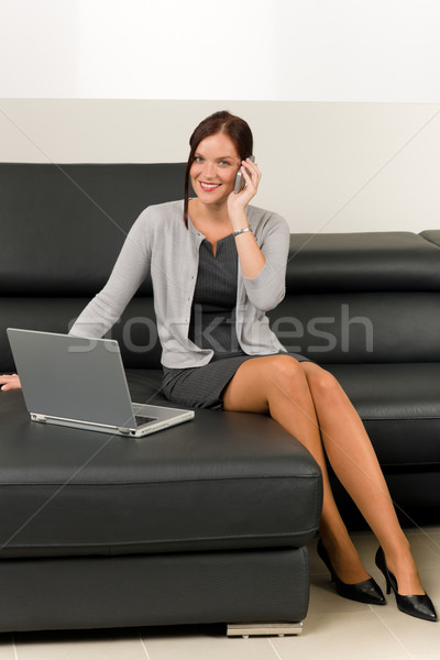 Elegant businesswoman on leather sofa call phone Stock photo © CandyboxPhoto