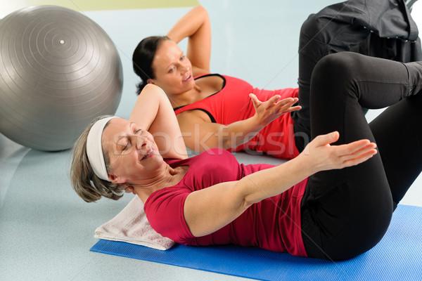 Fitness center senior woman exercise gym workout Stock photo © CandyboxPhoto