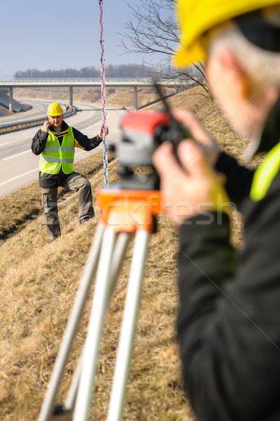 Geodesist measure land with tacheometer highway Stock photo © CandyboxPhoto