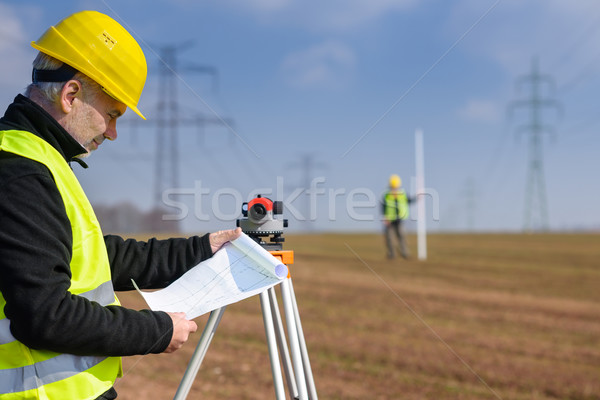 Geodesist measure land on construction site Stock photo © CandyboxPhoto