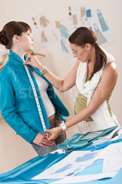Female fashion designer measuring jacket on model Stock photo © CandyboxPhoto